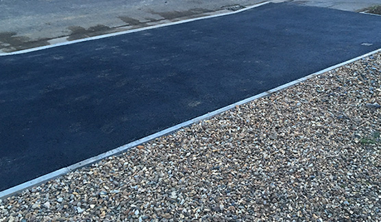 Northampton drop kerb specialists leading to residential gravel driveway
